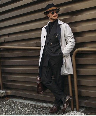 How to wear: black dress pants, black turtleneck, black double breasted blazer, white raincoat