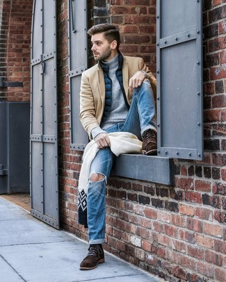 How to wear: blue ripped jeans, grey knit turtleneck, navy gilet, camel overcoat