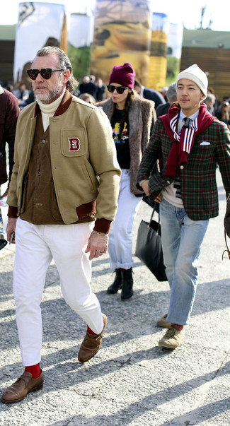 How to wear: white chinos, white knit turtleneck, brown gilet, beige varsity jacket