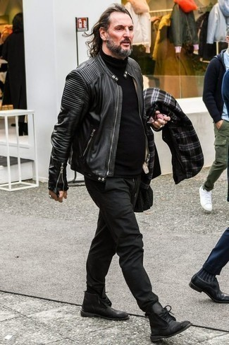 How to Wear Black Leather Desert Boots: This pairing of a black leather bomber jacket and charcoal chinos is extra versatile and creates instant appeal. Introduce black leather desert boots to the mix and ta-da: your outfit is complete.