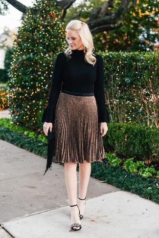 How to wear: black turtleneck, brown pleated midi skirt, black embellished suede heeled sandals, black fringe suede clutch