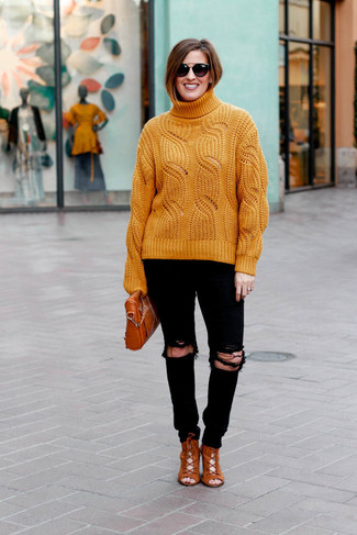 How to wear: orange knit turtleneck, black ripped skinny jeans, tobacco suede lace-up ankle boots, tobacco leather crossbody bag