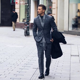 How to wear: black leather loafers, charcoal turtleneck, charcoal plaid suit, black overcoat