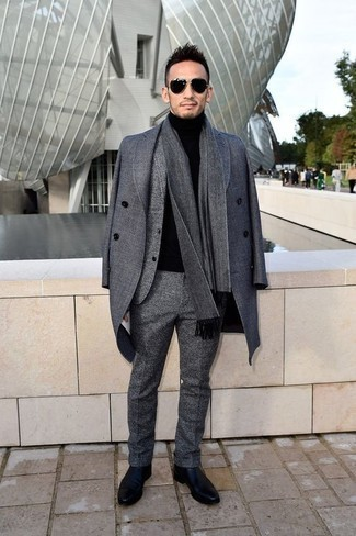 How to Wear a Grey Wool Suit: Marrying a grey wool suit and a grey overcoat will create a sophisticated, masculine silhouette. Complete your outfit with a pair of black leather chelsea boots to add a hint of stylish casualness to this ensemble.