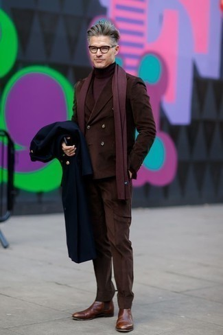 How to Wear a Navy Overcoat: Combining a navy overcoat with a brown suit is a savvy option for a classic and refined ensemble. For something more on the daring side to complete your outfit, throw in a pair of brown leather chelsea boots.
