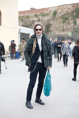 How to wear: black leather casual boots, white turtleneck, navy suit, olive camouflage parka