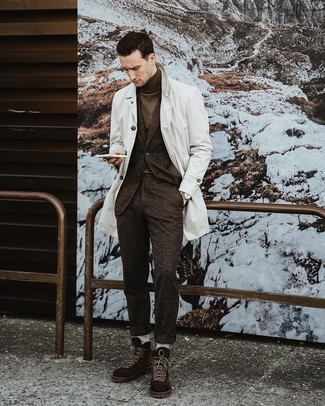 How to wear: dark brown suede casual boots, dark brown turtleneck, dark brown wool suit, white trenchcoat