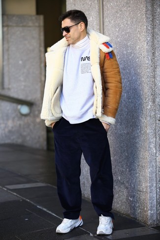 How to wear: navy corduroy chinos, white turtleneck, white and black print sweatshirt, tobacco shearling jacket