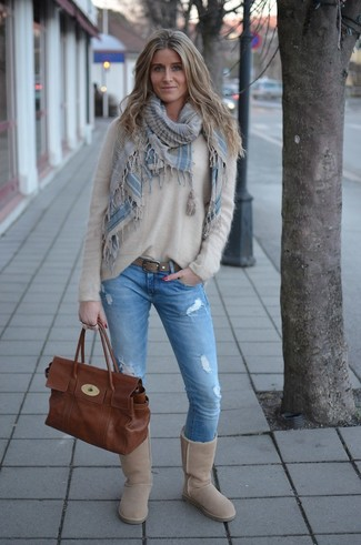 How to wear: brown leather satchel bag, beige uggs, light blue ripped skinny jeans, beige fluffy crew-neck sweater