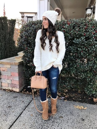 Women's Looks & Outfits: What To Wear In a Relaxed Way: Consider teaming a white knit oversized sweater with navy ripped skinny jeans for a casual getup. Here's how to bring a more relaxed aesthetic to this look: tan uggs.
