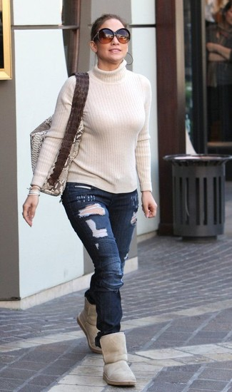 How to wear: beige snake leather tote bag, beige uggs, navy ripped skinny jeans, beige turtleneck