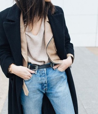 How to wear: light blue jeans, beige v-neck sweater, tan leather biker jacket, black coat