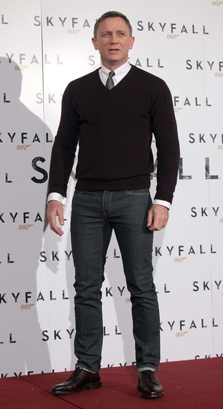 Daniel Craig wearing Black V-neck Sweater, White Dress Shirt, Charcoal Jeans, Burgundy Leather Brogue Boots