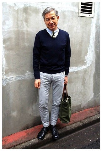 How to wear: navy v-neck sweater, white dress shirt, grey jeans, black leather derby shoes
