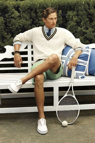 How to wear: beige v-neck sweater, light blue dress shirt, mint shorts, white canvas low top sneakers