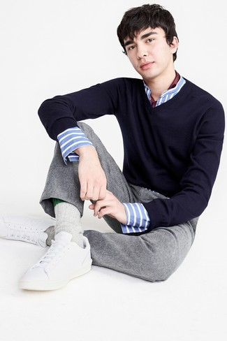 How to wear: navy v-neck sweater, white and blue vertical striped long sleeve shirt, grey wool dress pants, white leather low top sneakers