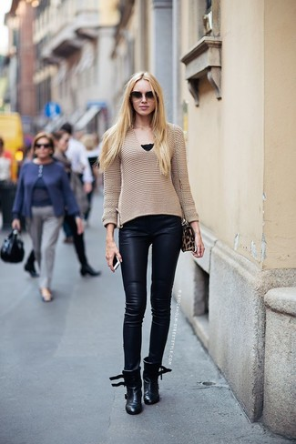 How to wear: tan v-neck sweater, navy leather skinny pants, black leather ankle boots, brown leopard suede crossbody bag
