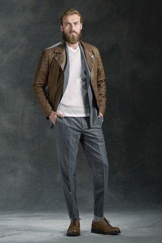 How to wear: white v-neck t-shirt, grey v-neck sweater, grey vertical striped suit, brown leather biker jacket