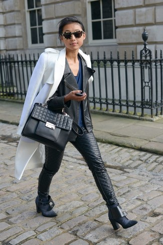 How to wear: black leather skinny jeans, navy v-neck t-shirt, black leather biker jacket, white coat