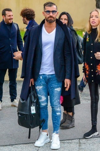 How to Wear Blue Ripped Skinny Jeans For Men: Loving how well a navy overcoat looks with blue ripped skinny jeans. Add a pair of white leather low top sneakers to the equation and you're all done and looking spectacular.