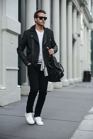 How to Wear Black Jeans For Men: A black biker jacket looks so casually dapper when paired with black jeans. The whole outfit comes together really well if you introduce white canvas low top sneakers to this look.