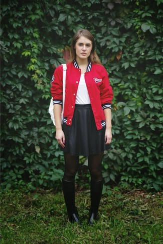 Try pairing a red baseball jacket with a black skater skirt for a lazy Sunday brunch. Dress down your ensemble with black rain boots. We guarantee this combo is the answer to all of your springtime style struggles.
