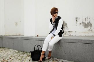 How to wear: black and white varsity jacket, grey polo, white capri pants, black leather heeled sandals