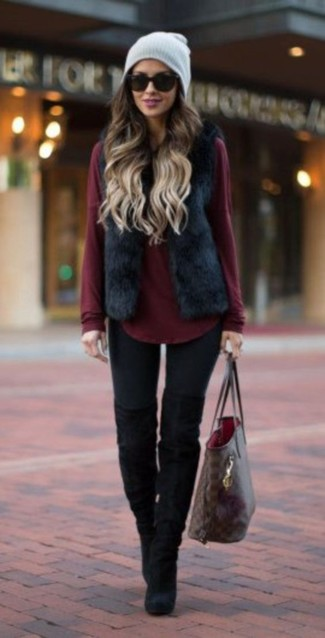 The versatility of a black fur vest and a grey beanie makes them investment-worthy pieces. Why not introduce black suede over the knee boots to the mix for an added touch of style? No doubt, an ensemble like this will keep you warm and stylish during the fall.