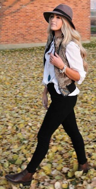 A brown fur vest and a hat are a great outfit formula to have in your arsenal. Throw in a pair of dark brown leather booties to take things up a notch. These picks will keep you comfy and stylish in awkward transition weather.