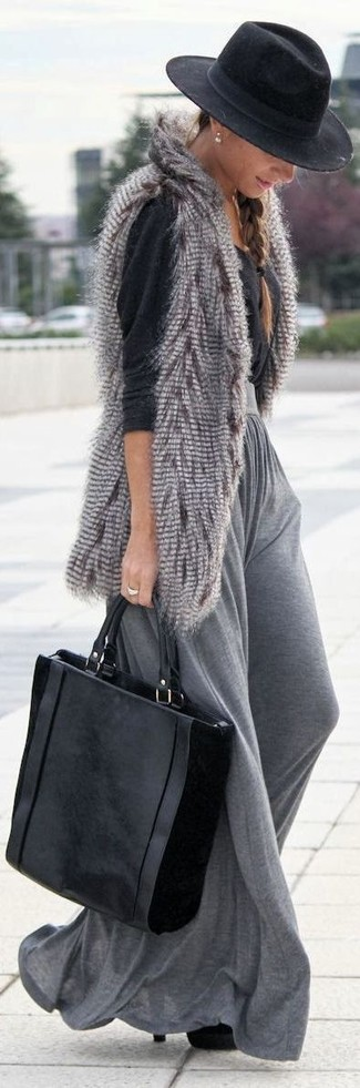 Stay stylish on busy days in a grey fur vest and a hat. Polish off the ensemble with black suede booties. When leaves change color and autumn settles in, you'll love this ensemble as your go-to for transeasonal weather.