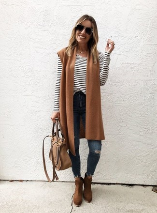 How to wear: tan wool vest, white and black horizontal striped long sleeve t-shirt, navy ripped skinny jeans, brown suede ankle boots