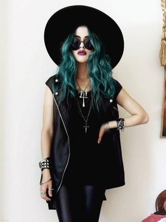 How to wear: black leather vest, black tank, black leather leggings, black wool hat