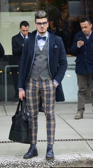 How to wear: light blue dress shirt, grey waistcoat, blue wool blazer, black overcoat
