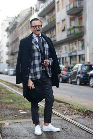 How to Wear Charcoal Chinos: Wear a black overcoat with charcoal chinos for a sharp combo. Don't know how to round off? Introduce a pair of white low top sneakers to the equation for a more casual vibe.