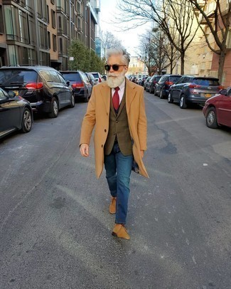 Men's Looks & Outfits: What To Wear In Cold Weather: Inject style into your daily lineup with a camel overcoat and blue jeans. Serve a little mix-and-match magic by finishing off with tan suede desert boots.