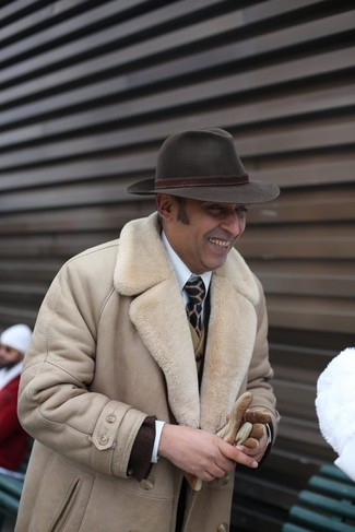How to wear: white dress shirt, olive wool waistcoat, dark brown blazer, beige shearling coat