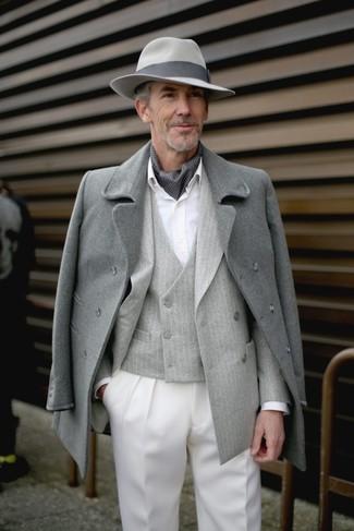 How to wear: white dress shirt, grey vertical striped waistcoat, grey vertical striped double breasted blazer, grey overcoat