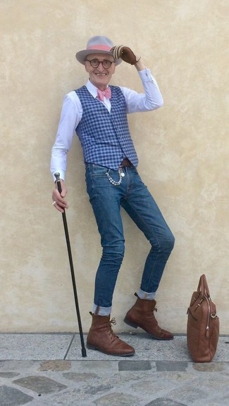 How to wear: blue gingham waistcoat, white dress shirt, blue skinny jeans, brown leather dress boots