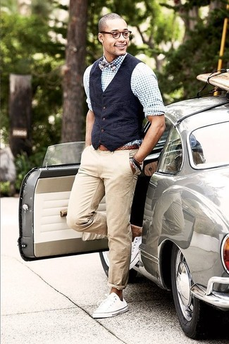 How to wear: navy cotton waistcoat, white and blue gingham long sleeve shirt, beige chinos, white low top sneakers
