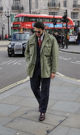 How to wear: white dress shirt, black waistcoat, black check suit, olive military jacket