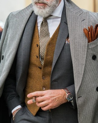 How to wear: white dress shirt, brown wool waistcoat, charcoal suit, grey herringbone overcoat