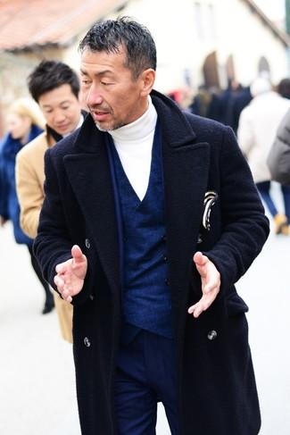 How to wear: white turtleneck, navy waistcoat, navy suit, navy overcoat