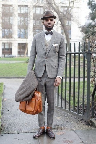 How to Wear a Grey Overcoat: This pairing of a grey overcoat and a grey plaid suit will add elegant essence to your outfit. A pair of dark brown leather oxford shoes is a good choice to complete this ensemble.