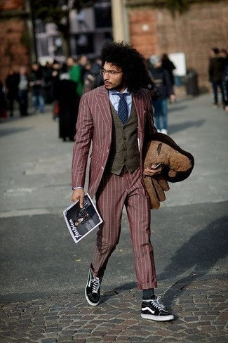Men's Looks & Outfits: What To Wear In 2020: A brown suede shirt jacket and a burgundy suit are among the crucial items in an elegant man's wardrobe. Finishing with a pair of black and white canvas high top sneakers is a guaranteed way to add a dose of stylish nonchalance to this outfit.