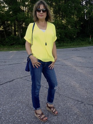 How to wear: blue leather crossbody bag, brown leather wedge sandals, blue ripped boyfriend jeans, yellow v-neck t-shirt