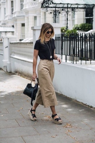How to wear: black leather clutch, black leather wedge sandals, tan culottes, black crew-neck t-shirt