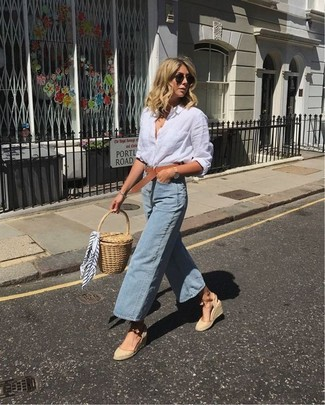 How to wear: tan straw clutch, beige canvas wedge sandals, light blue denim culottes, white linen dress shirt