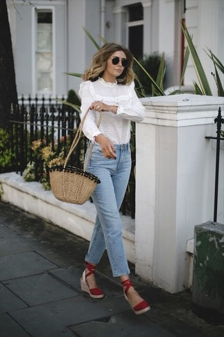 How to wear: tan straw crossbody bag, red suede wedge sandals, light blue jeans, white ruffle long sleeve blouse