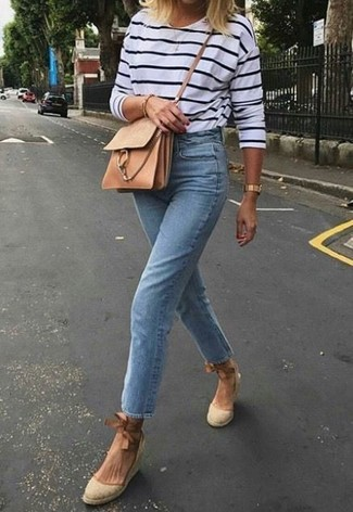 How to wear: tan leather crossbody bag, beige canvas wedge sandals, light blue jeans, white and navy horizontal striped long sleeve t-shirt