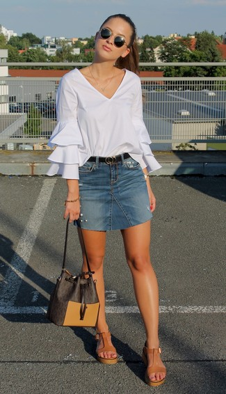 How to wear: dark brown leather bucket bag, tan leather wedge sandals, blue denim mini skirt, white ruffle long sleeve blouse